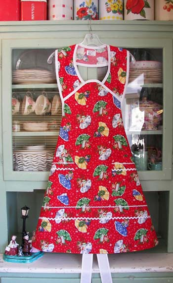 b73b2d10e 1940 apron in Christmas Girls, Woman Christmas girls #2034 $49.95, extra  large $54.95 and girl matching apron #308 $39.95, child large $44.95.