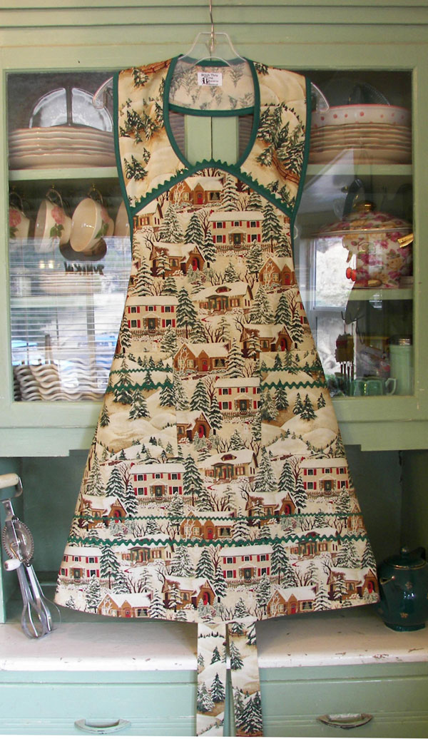 1940 Old Time Village Christmas apron with green trim and Ric Rac