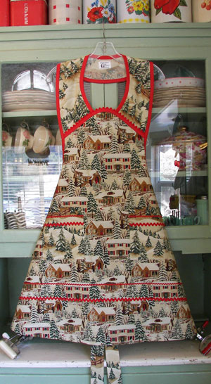 1940 Old Time Village Christmas Apron with red trim and ric rac, click for larger view