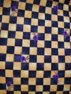 1940 apron comes in this fun black/orange gingham with purple spiders.