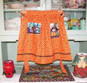 Hokus Pokus  child half apron in orange yellow