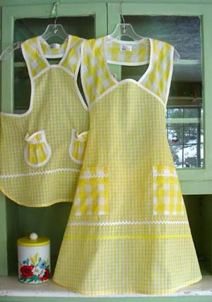 1940 Girl yellow gingham apron with woman 1940 apron